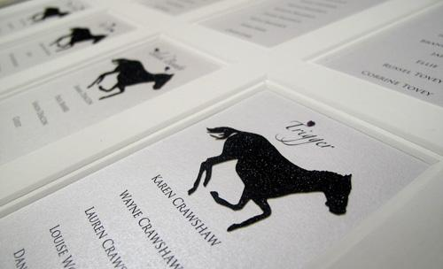 Detail of our laser cut race horses in black micro glitter
